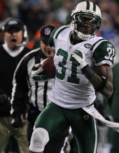 Antonio Cromartie of the Jets races down the sideline for 23 yards after scooping up the Patriots' first onside kick.