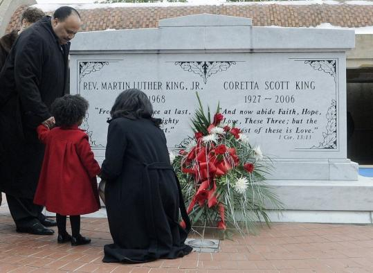 Martin Luther King III, with his daughter and wife, marked the holiday yesterday at the crypt of his parents, civil rights leader Martin Luther King Jr. and Coretta Scott King, in Atlanta.
