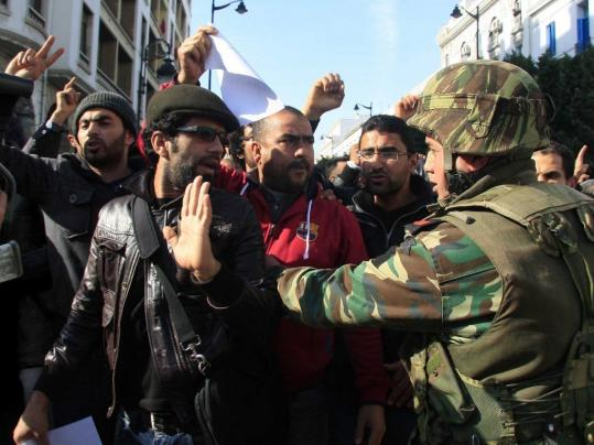 Protesters came face-to-face with soldiers during a demonstration in Tunis yesterday. The Tunisian government said that 78 civilians have died during a month of unrest.