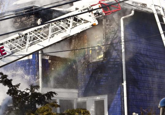 "In an effort to determine the cause of this fatal house fire in Somerville, investigators sifted through the debris ""on their hands and knees,'' said fire Chief Kevin Kelleher."