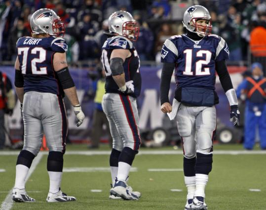 It's a little too soon to tell whether tackle Matt Light (left) and guard Logan Mankins will be among those protecting quarterback Tom Brady (12) next season for the Patriots.