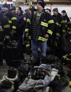 Firefighters in Camden waited to turn in their gear yesterday after being laid off amid a city budget crisis.