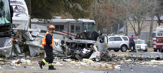 Police officers secured the area at the scene of a plane crash that left two people dead in North Myrtle Beach, S.C., Tuesday.