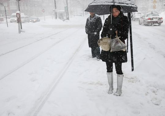 In Brookline yesterday, Annette Chung waited for a train that would take her to work.