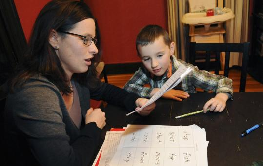 Lisa Mozden Romaniw helped her son, Kaden, 6, with his homework on a recent afternoon. She relocated from Los Angeles to the Boston area six years ago and has been looking to break into the film and video editing industry here.