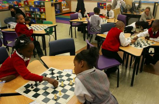 Students learned to play chess during a class at Promise Academy 2, run by Harlem Children's Zone. The group, which created a web of community services in Harlem to aid impoverished children and families, has become a model for similar efforts.