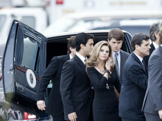 Maria Shriver, her husband Arnold Schwarzenegger (right), and other loved ones carried the casket of Sargent Shriver into Our Lady of Mercy Church in Potomac, Md., yesterday.