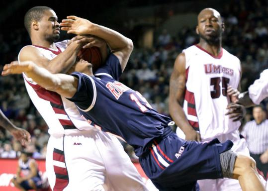 Terrell Vinson of UMass gets the ball, but also a lot of Francis-Cedric Martel, who was fouled.