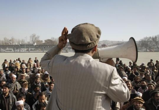 Losing candidate Najibullah Mujahid addressed a crowd through a loud speaker during a protest in Kabul, Afghanistan.