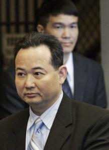 Nam The Tham (front) and Siny Van Tran entered Suffolk Superior Court in Boston during their 1991 trial.