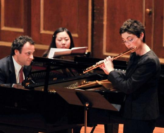 Guest pianist Jonathan Bass performs Lowell Liebermann's Sonata for Flute and Piano with flutist Elizabeth Rowe at Jordan Hall on Sunday.