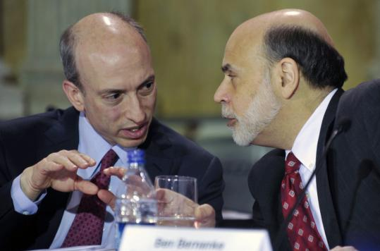 Gary Gensler (left), chairman of the Commodity Futures Trading Commission, conferred with Ben Bernanke, Fed chairman, at a Financial Stability Oversight Council meeting.