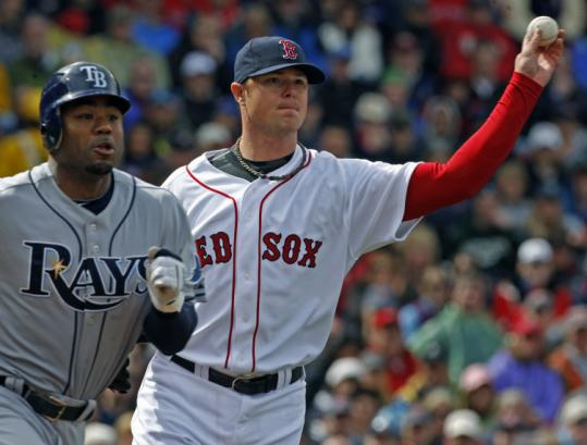 An added bonus of the Sox signing Carl Crawford (left) is that Jon Lester won't be battling to keep him off the base paths.