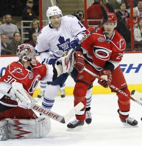 Hurricanes goaltender Cam Ward was assisted by Ryan Carter in keeping Toronto's Fredrick Sjostrom away from the goal.