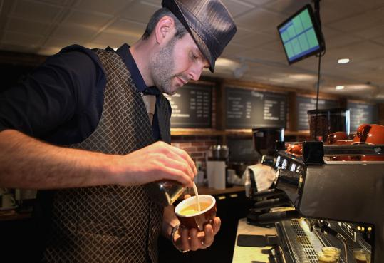 Barista Phil Roberts makes a hazelnut latte at Thinking Cup.