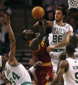 Celtics center Semih Erden notches one of his two blocked shots last night, this one against the Cavaliers' J.J. Hickson.