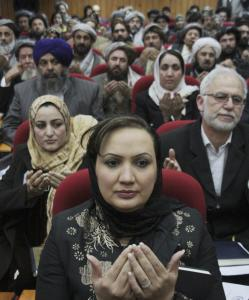 Afghan lawmakers prayed during the inauguration of the country's new Parliament in Kabul yesterday.