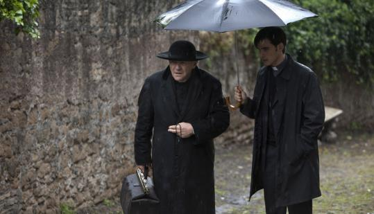 "Anthony Hopkins as Father Lucas and Colin O'Donoghue as Father Michael in ""The Rite.''"