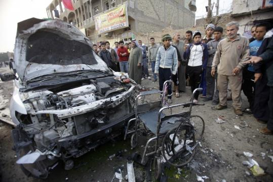 A car bomb ripped through a funeral tent in a mainly Shi'ite area of Baghdad yesterday. Recent violence has raised new concern about the readiness of the Iraqis to take over their security.