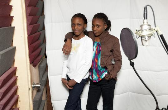 Oladunni Oladipo (right), 12, and her sister Olayeni, 10, at 12th Note Productions in Roxbury this month.