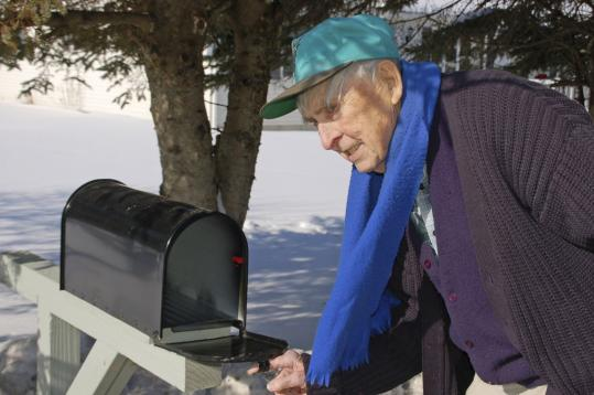 Robert Rhein checked his newly erected mailbox at his home in Lyndonville, Vt., yesterday. He had relied on his daughter to bring him his mail. A group of disability advocates helped Rhein.