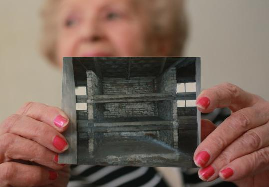 Holocaust survivor Anna Arbeiter showed a photo her husband, Israel, took of her bunk at Auschwitz.