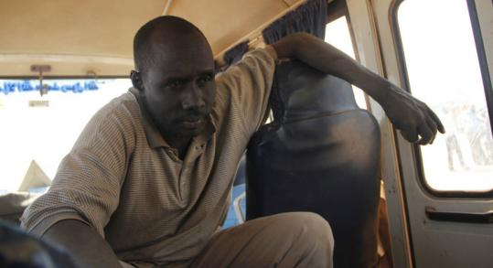 Athou Ahmed Mohammed was a bus driver in a convoy taking southern Sudanese home when it was attacked by gunmen.