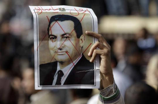 A protester held a defaced poster of President Hosni Mubarak with the words ''Mubarak, get out'' at a demonstration in Cairo.