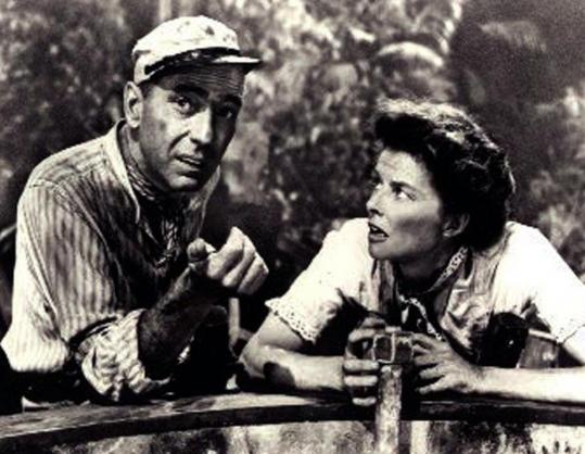 "Humphrey Bogart, as Charlie Allnut, with Katharine Hepburn, as Rose Sayer, in a scene from ""The African Queen'' in 1951."
