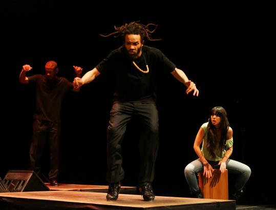 "Savion Glover brought ""SoLo iN TiME'' to Boston Saturday night, with fellow dancer Marshall Davis Jr., accompanied by percussionist Carmen Estevez. Here they are pictured in New York."