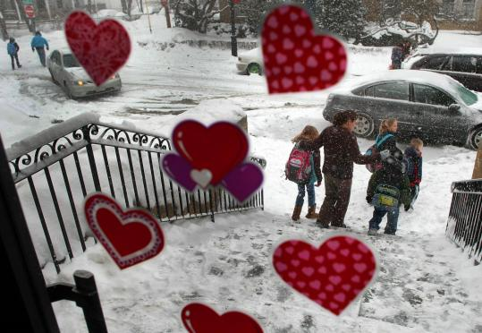 Parents came to pick up their schoolchildren during early dismissal yesterday at the Quincy Catholic Academy, where hearts were put on the front door in anticipation of Valentine's Day.