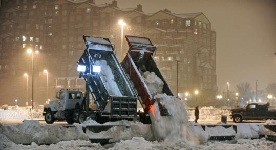 Dump trucks filled with snow dumped their cargo into Baltimore's Inner Harbor last February.