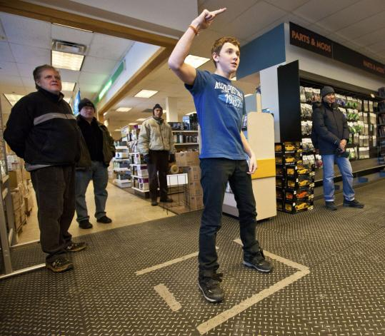 Avery Sargent, 14, of Somerville played Dance Central on an Xbox 360 game console at Micro Center in Cambridge last week.