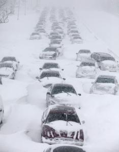 Abandoned vehicles blocked Lake Shore Drive in Chicago yesterday. Officials could not say when the road would reopen.