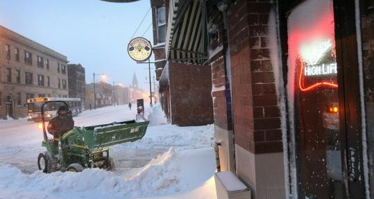 The latest storm dumped 19.5 inches on the Chicago area, halting business in Wicker Park (above) and at O'Hare airport.