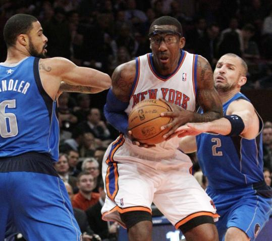 Knicks' Amar'e Stoudemire drives past Mavericks' Tyson Chandler and teammate Jason Kidd but New York lost to Dallas on its home floor.