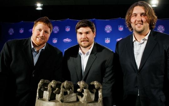 Dan Koppen (left), Dan Connolly (center), and Mark LeVoir represented the Patriots offensive line, voted the NFL's best.