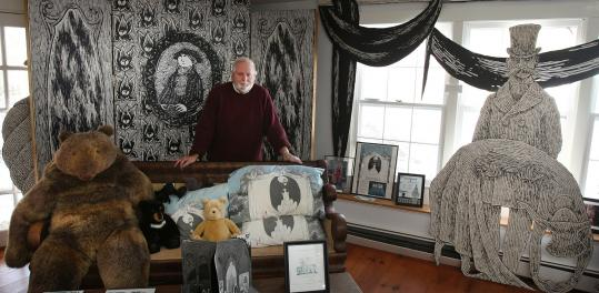 Rick Jones, the director and curator of the Edward Gorey House in Yarmouth Port, with items in Gorey's collection.