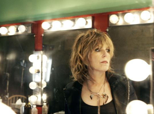 Lucinda Williams says that her latest album shows she is 'learning how to write about other things besides unrequited love.'