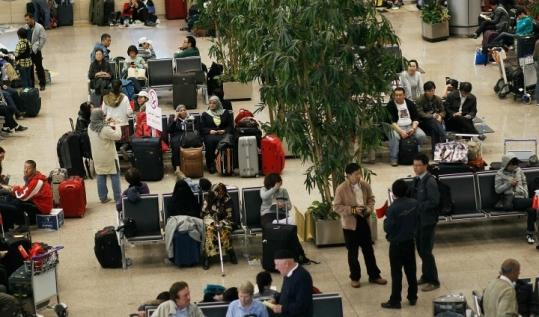People waited for flights in Cairo. Several companies have activated emergency plans to evacuate their employees.