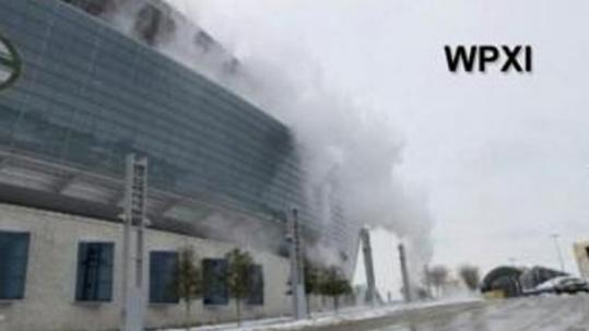This video image courtesy of WPXI-TV in Pittsburgh shows snow and ice sliding off the roof of Cowboys Stadium.