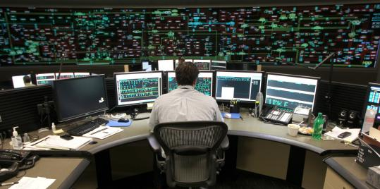 Electric Grid Monitor : National grid employees work to keep electrical juice