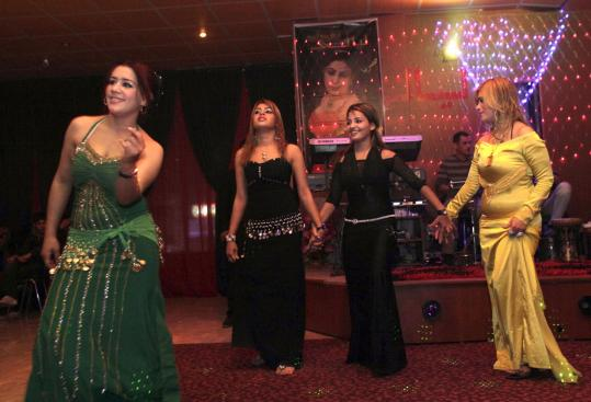 Dancers of the Night members performed at a club in Sulaimaniyah, Iraq, last month. Dozens of dance halls and clubs have recently opened across the Kurdish region as the Kurds seek to capitalize on a crackdown against alcohol in Baghdad.