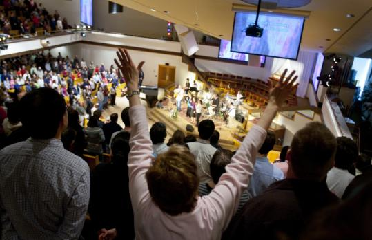 Congregants sang during a recent service at Grace Chapel in Lexington, an evangelical megachurch that is still growing.