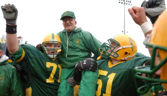 His 212th victory at Clinton High secured, Archie Cataldi was hoisted by players following his final game as the Gaels' coach.