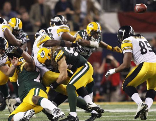 This jarring hit by linebacker Clay Matthews caused Steelers running back Rashard Mendenhall to fumble in the fourth quarter.