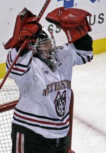 Chris Rawlings strikes a pose after stopping all 41 Harvard shots in the Huskies' Beanpot-opening shutout win.