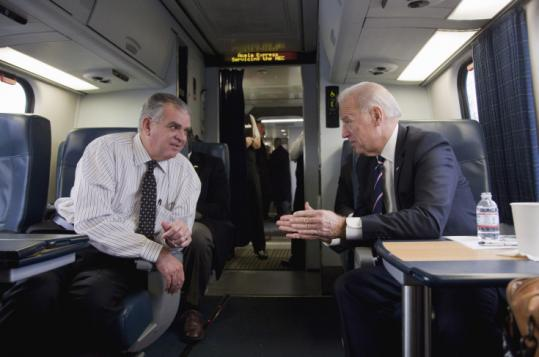 Vice President Joe Biden talked with Transportation Secretary Ray LaHood yesterday on a train heading to Philadelphia, where they touted plans to improve the nation's rail system.