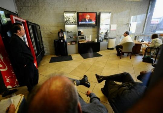 People at a Los Angeles Toyota dealership watched Secretary of Transportation Ray LaHood's press conference yesterday revealing the results of an investigation into Toyota crashes.