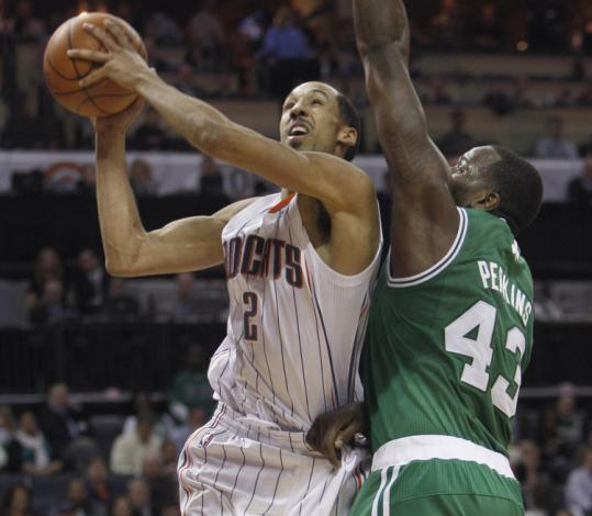 With the Celtics hurting, Kendrick Perkins (right) played more than 30 minutes for the third straight game Monday.